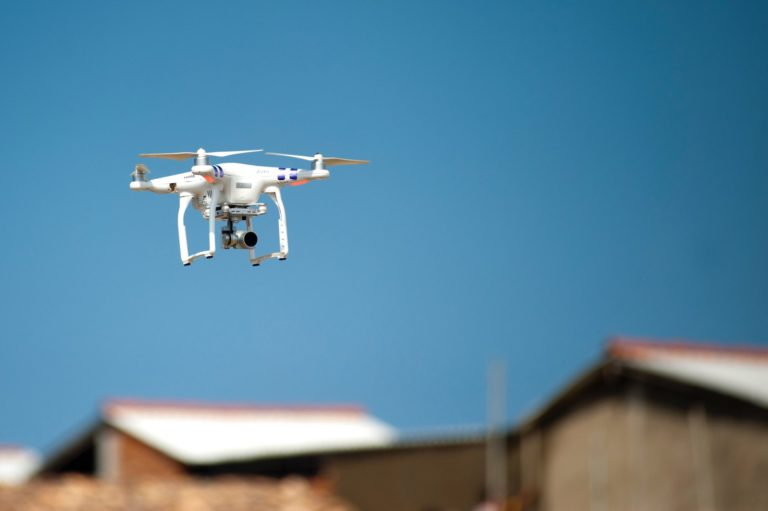 UAV Flying over Building - Drone Inspections