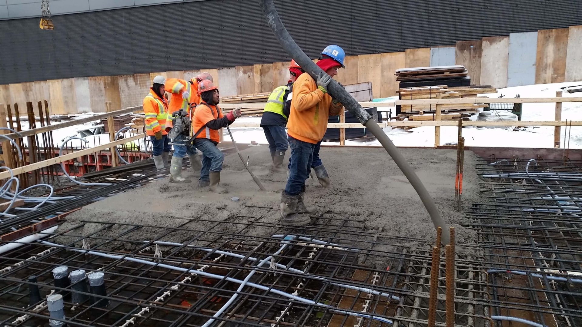 Workers placing concrete in cold weather